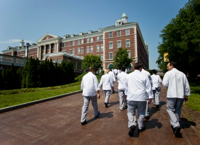 Students walk to class in their chef attire!